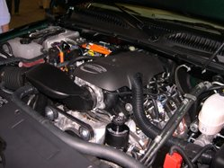 Engine compartment of a 2006 GMC Sierra Hybrid